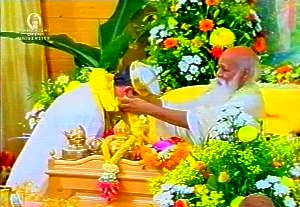 Maharishi is offering a Garment of Flower to the King